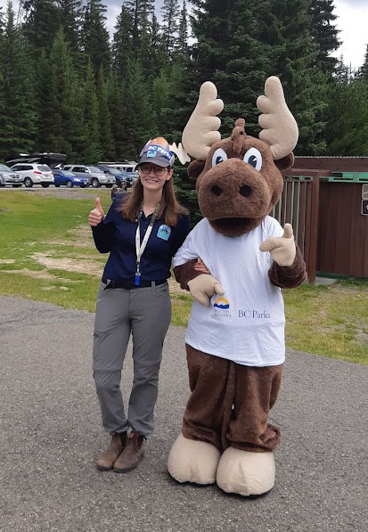 Student ranger posing besides Jerry the Moose mascot at E.C. Manning Provincial Park